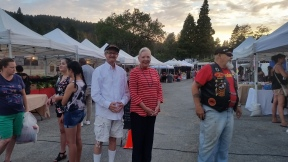 Russ Keller and Jeannie Venturini attend the Lake Gregory Market Night to accept trophies for the Jamboree Days Parade.