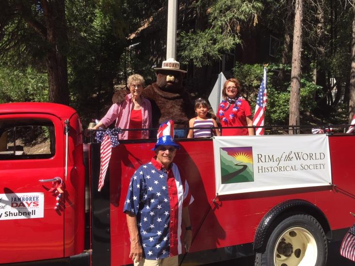 Smokey the Bear joins the parade.